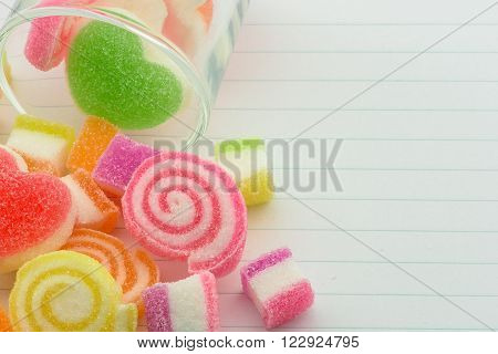 Sweet jelly candies and jelly hearts in sweet color and partial blurred style.