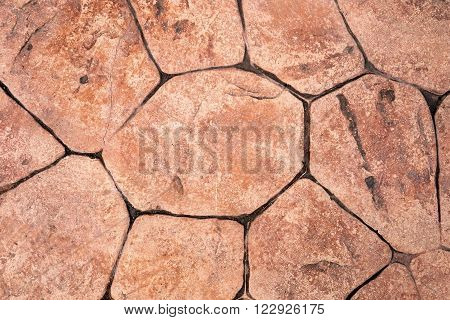 Texture of stones in brown colour on floor. Stone brick floor background.