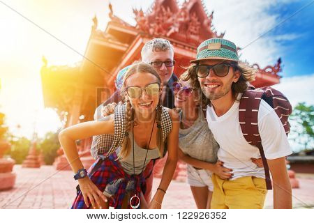 tourists posing in front of temple in koh samui thailand shot with selective focus and lens flare,