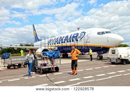VILNIUS, LITHUANIA - JULY 22, 2015: Passengers boarding Ryanair flight in Vilnius, Lithuania. Ryanair is biggest budget low-cost airline in the world.