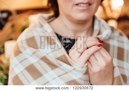 adult woman with a ring on his hand hid rug in the cage