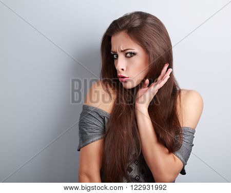 Refused Grumpy Young Brunette Woman With Hand Hear Face And Surprising Eyes