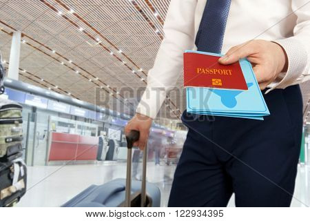 Passport control. Traveling businessman handing passport and ticket