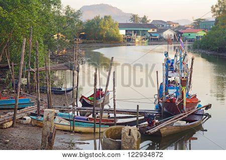 sea gypsies fishing village in Thailand, fishing boats