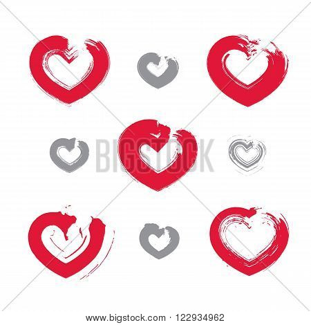 Set of hand-drawn red love heart icons collection of loving heart signs created with real hand-drawn ink brush scanned and vectorized symmetric hand-painted love symbols isolated on white background.