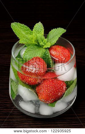 Refreshing summer drink with strawberry and mint in glasses