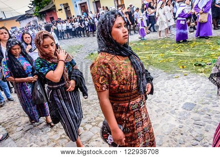 Antigua Guatemala - March 20 2016: Indigenous women dressed in their everyday traditional costumes participate in Palm Sunday procession in colonial town with most famous Holy Week celebrations in Latin America.