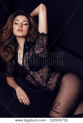 Woman With Dark Hair Wears Elegant Lace Blouse And Pantyhose