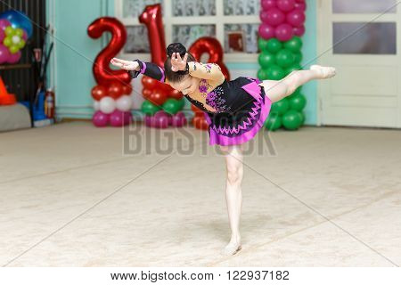 Elegant Girl Doing Crafty Trick On Gymnastics Performance