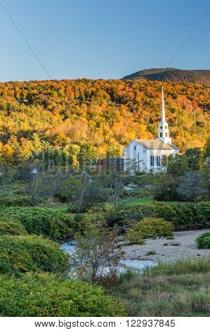 Fall Foliage landscape and Church in Stowe Vermont.