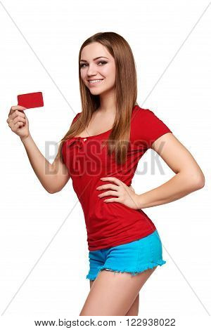 Beautiful bright smiling confident girl showing red card in hand, over white backround