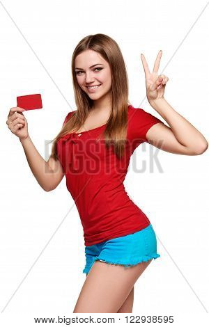 Beautiful bright smiling confident girl showing red card in hand and gesturing OK sign, over white backround