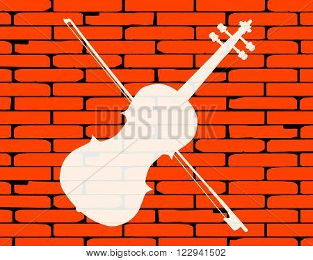 A well worn wall painted with a country fiddle in white.