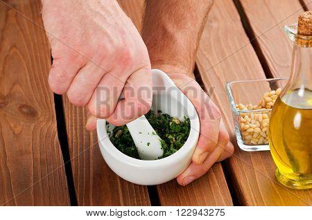 Close Up Man's Hands  Preparing Pesto