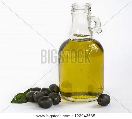 olive oil bottle with olives on white background