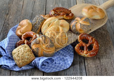 Fresh Bavarian rolls and pretzels on a vintage baking board