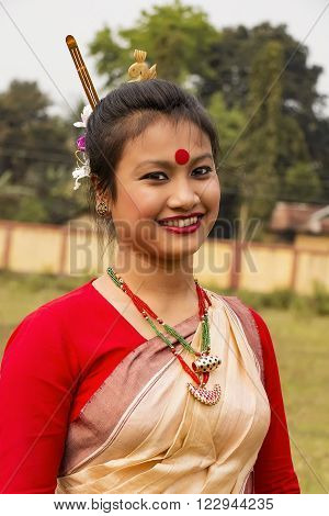 JORHAT, ASSAM/ INDIA - MARCH 21: A dancer in  traditional Bihu Dance costume  . The Bihu dance is a folk dance from the Indian state of Assam related to the Bihu festival.