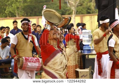 JORHAT, ASSAM/ INDIA - MARCH 21: A dancer performs traditional Bihu Dance . BihuThe Bihu dance is a folk dance from the Indian state of Assam related to the Bihu festival.