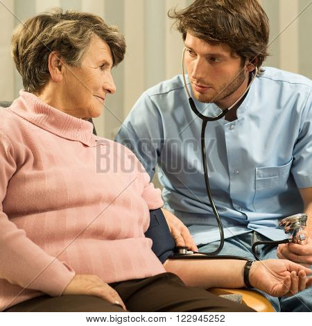 Cardiologist Measuring Blood Pressure