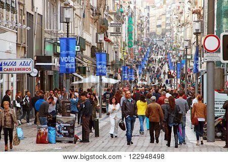 PORTO, PORTUGAL - OCTOBER 5, 2015: People walking on the main shopping street Rua de Santa Catarina in the center of Porto