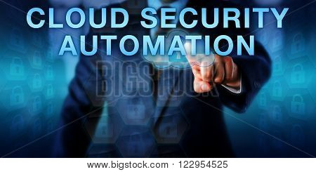 Manager is pushing CLOUD SECURITY AUTOMATION on a touch screen. Information technology concept and computer security metaphor for automating protective mechanisms and processes securing the cloud.