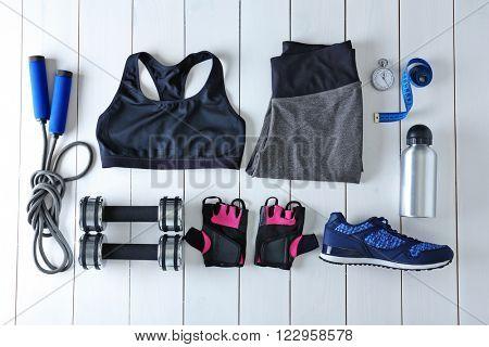 Female sport equipment on a white background