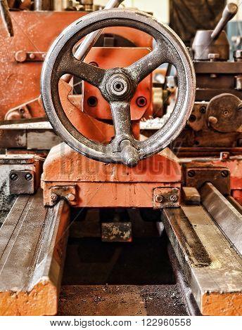 Mechanical engineering.Lathe in workshop taken closeup.Toned image.