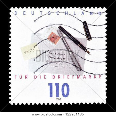 GERMANY - CIRCA 2000 : Cancelled postage stamp printed by Germany, that shows Letter and pencils.