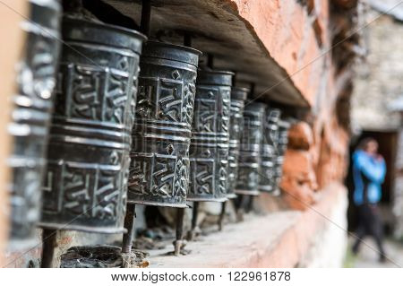 Closeup of Tibetan praying wheels. Annapurna circuit in Nepal.