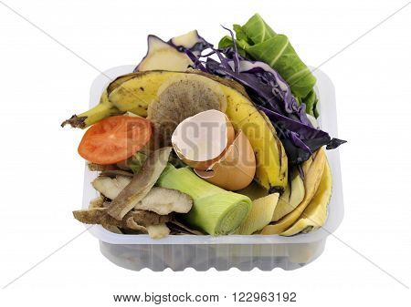 Fruit and vegetable household kitchen food waste collected in re-used packaging for composting.