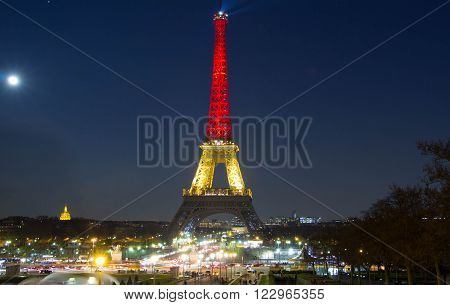 Paris; France-March 22 2016 : The Eiffel tower lit up with the colors of National Belgian flag to honor to victims of terrorist's attack in Brussels.
