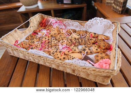 Fresh baked homemade shortbread cookies on cookie tray. Cookies in the form of hearts. cookies with a pink ribbon