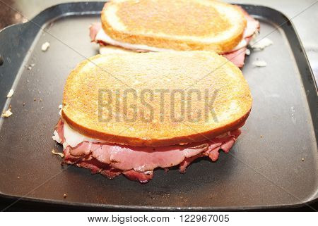 Cooking Two Thick Ruben Sandwiches on a Griddle