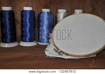 Set for embroidery of colorful threads, hoops, thimble and need