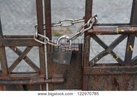 Lock and chain on an old rusty gate