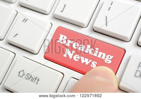 Pressing red breaking news key on keyboard