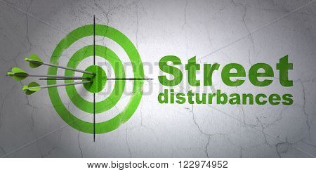 Political concept: target and Street Disturbances on wall background