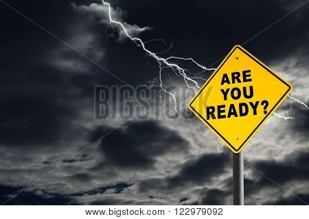 Are You Ready road sign against a dark cloudy and thunderous sky. Conceptually warning of danger ahead.
