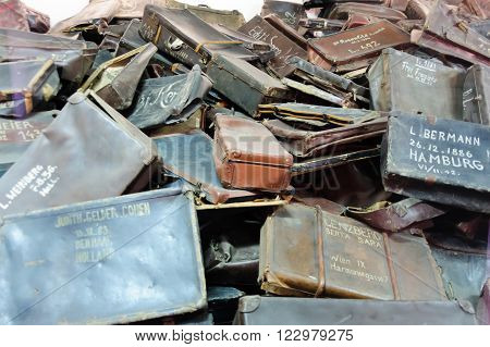 OSWIECIM, POLAND - JULY 3, 2009: Auschwitz I - Birkenau, suitcases collected from prisoners exhibited in Block 5 as Material Evidence of Crimes commited