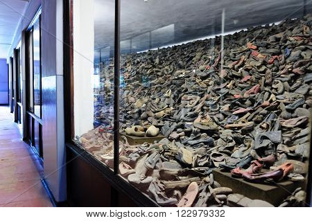 OSWIECIM, POLAND - JULY 3, 2009: Auschwitz I - Birkenau, shoes collected from prisoners exhibited in Block 5 as Material Evidence of Crimes commited