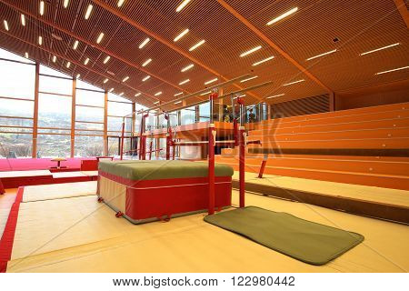 Gymnastic center and equipment for training gymnastics