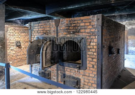 OSWIECIM, POLAND - JULY 3, 2009: Auschwitz I - Birkenau ovens and equipment in the crematorium are all reproductions, representing double-muffle single-door ovens