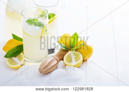 Fresh homemade lemonade in tall glasses with ice
