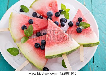 Watermelon popsicles for kids with blueberry on the plate