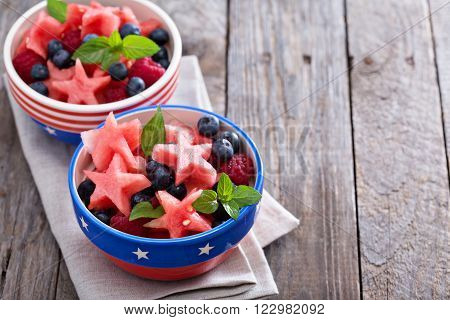 Fruit salad with watermelon shaped as stars and blueberries