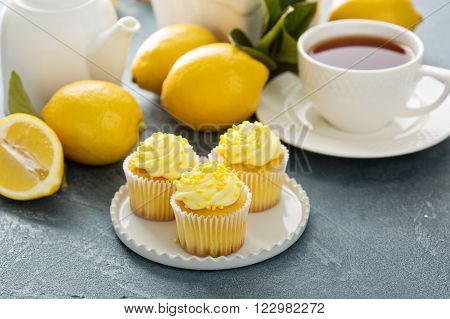 Lemon cupcakes with bright yellow frosting and sprinkles
