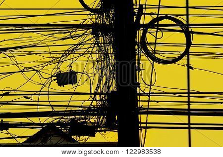high-voltage power pole wiring mess of thousands : Tangled wires