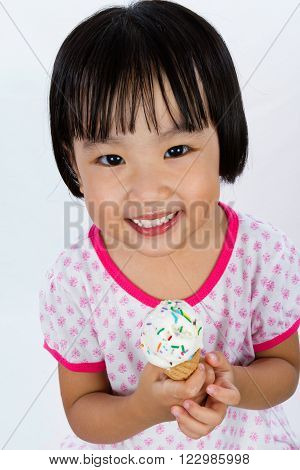 Asian Little Chinese Girl Eating Ice Cream isolated on White Background ** Note: Soft Focus at 100%, best at smaller sizes