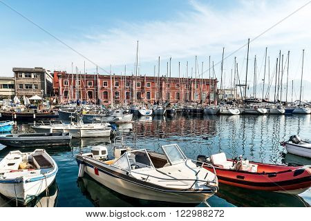 Street view of Naples harbor with boats, italy Europe.