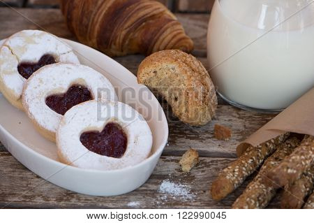 Valentine cookies. Romantic breakfast. Various cookies on the wooden table.
